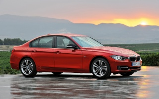 2012 BMW 3 Series Sedan Sport Line Side Angle wallpapers and stock photos
