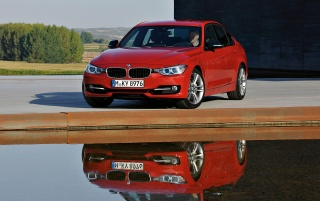 Random: Red BMW 3 Series Sedan Sport Line Front Angle Reflection