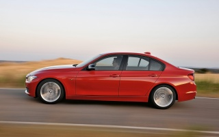 Red BMW 3 Series Sedan Sport Line Side wallpapers and stock photos