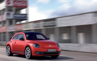 2012 Red VW Beetle Front Angle wallpapers and stock photos