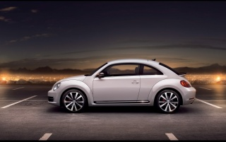2012 Volkswagen Beetle White Side wallpapers and stock photos