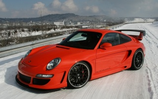Red Porsche Snow Drift wallpapers and stock photos