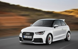2012 Audi A1 Quattro Front Angle Speed wallpapers and stock photos
