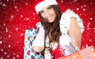 Santa girl with presents wallpapers and stock photos