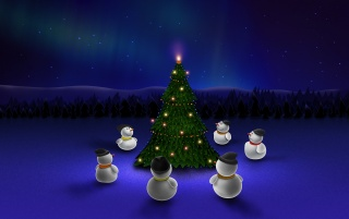 Snowmen around tree wallpapers and stock photos