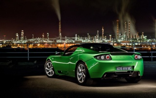 Green Tesla Roadster wallpapers and stock photos