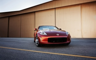 Nissan 370Z Magma Red Front Angle wallpapers and stock photos