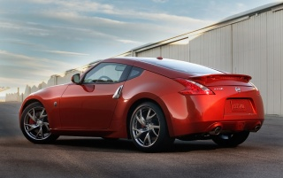 Nissan 370Z Magma Red Side wallpapers and stock photos