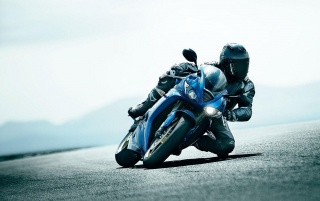 Super-motocicleta pe Track wallpapers and stock photos