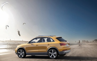 2012 Yellow Audi Q3 jinlong yufeng Side wallpapers and stock photos