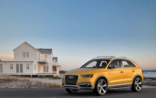2012 Yellow Audi Q3 jinlong yufeng Side Angle wallpapers and stock photos