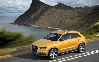 2012 Yellow Audi Q3 jinlong yufeng Side Speed wallpapers and stock photos
