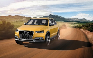 2012 Yellow Audi Q3 jinlong yufeng Front Speed wallpapers and stock photos