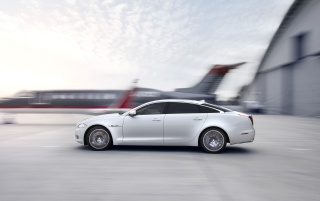 2012 Jaguar XJ Ultimate Motion Left Side wallpapers and stock photos