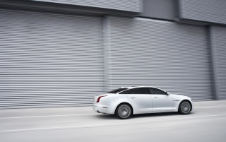 2012 Jaguar XJ Ultimate Motion Right Side wallpapers and stock photos