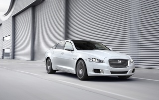 2012 Jaguar XJ Ultimate Front Angle Motion wallpapers and stock photos