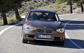 2012 BMW 1 Series Three Door 125d Motion Front wallpapers and stock photos