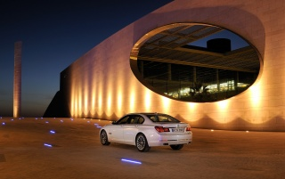 2012 BMW 7 Series Static Rear Side Angle Night wallpapers and stock photos