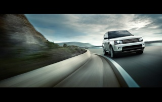 2013 Land Rover Range Rover Sport Motion ángulo frontal wallpapers and stock photos