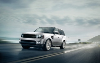 2013 Silver Land Rover Range Rover Sport Motion Side Angle wallpapers and stock photos