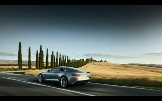 2013 Aston Martin Vanquish Motion Side wallpapers and stock photos