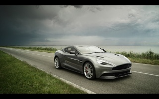 2013 Aston Martin Vanquish Motion Front Angle wallpapers and stock photos