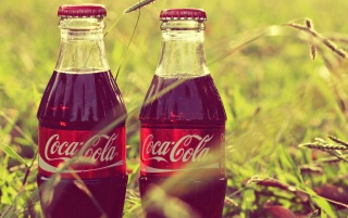 Coke Bottles in the Grass wallpapers and stock photos