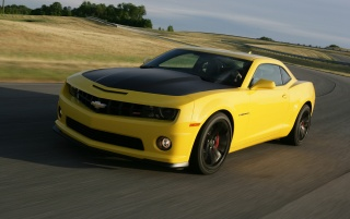 2013 Chevrolet Camaro 1LE Yellow Motion Front Angle wallpapers and stock photos