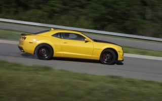 2013 Chevrolet Camaro 1LE Yellow Motion Side wallpapers and stock photos