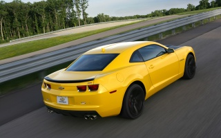 2013 Chevrolet Camaro 1LE Yellow Motion Rear Angle wallpapers and stock photos