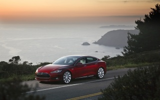 2012 Tesla Model S Red Side Angle wallpapers and stock photos