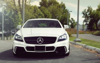 White Mercedes-Benz CLS 63 AMG Front wallpapers and stock photos