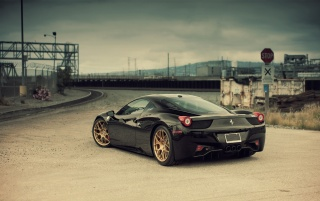 Black Ferrari 458 Italia Rear Angle wallpapers and stock photos