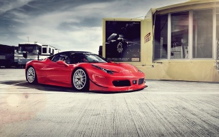 Red Ferrari 458 Italia GT3 Side Angle wallpapers and stock photos