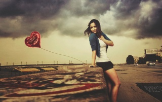 Beautiful Brunette with Heart Shaped Balloon wallpapers and stock photos