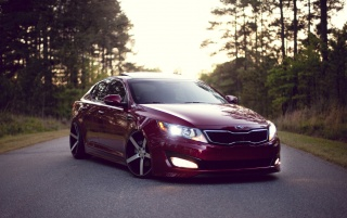 Burgundy Kia Optima Front Angle wallpapers and stock photos