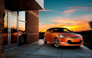 Orange Hyundai Veloster at Sunset wallpapers and stock photos
