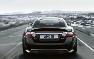 Black Jaguar XKR Rear Speeding wallpapers and stock photos