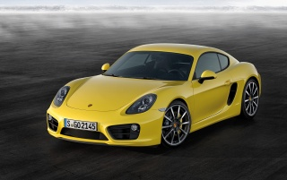 2013 Yellow Porsche Cayman Static Front Angle wallpapers and stock photos