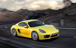 2013 Yellow Porsche Cayman Motion Side Angle wallpapers and stock photos