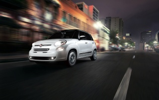 2014 Fiat 500L Front Side Angle Motion at Night wallpapers and stock photos