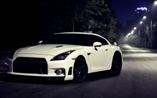 White Nissan 35 GTR at Night wallpapers and stock photos