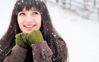 Brunette With Green Gloves in Snow wallpapers and stock photos