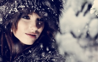 Random: Brunette Model With Fur Hat in the Snow