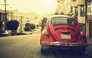 Old Red Volkswagen Beetle in the Street wallpapers and stock photos
