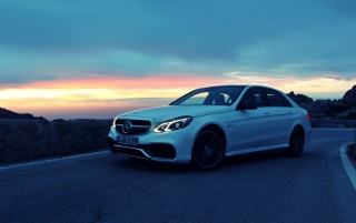 White Mercedes Benz E63 AMG wallpapers and stock photos
