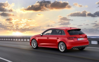 2013 Audi S3 Sportback Motion Side Angle wallpapers and stock photos