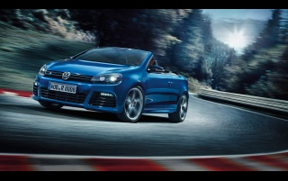 2013 Volkswagen Golf R Cabriolet Motion Side Angle wallpapers and stock photos