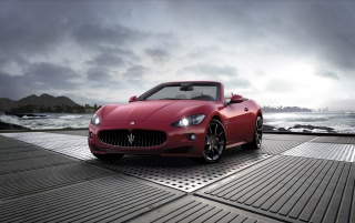 Red Maserati Cabrio Sport 2011 Front Angle wallpapers and stock photos