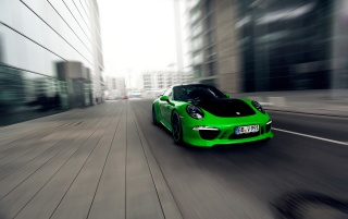 2013 TechArt Porsche 911 Carrera 4S Motion Front Angle wallpapers and stock photos